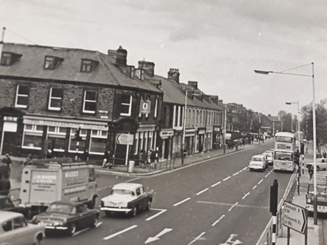 Old photo of Gosforth High Street showing T punshon Newsagent