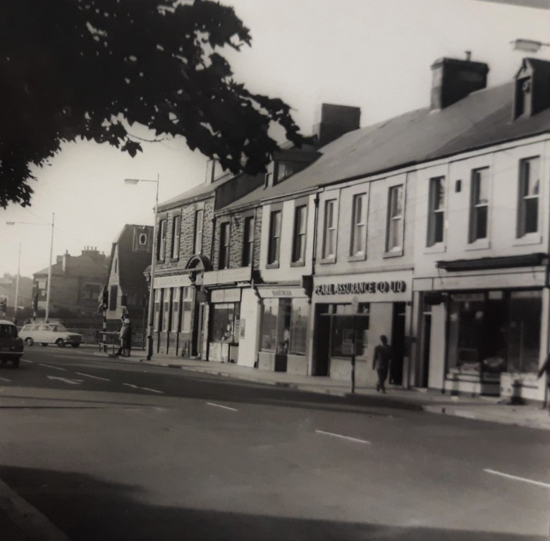 Old photo of TGosforth High Street showing T Punshon Newsagaent