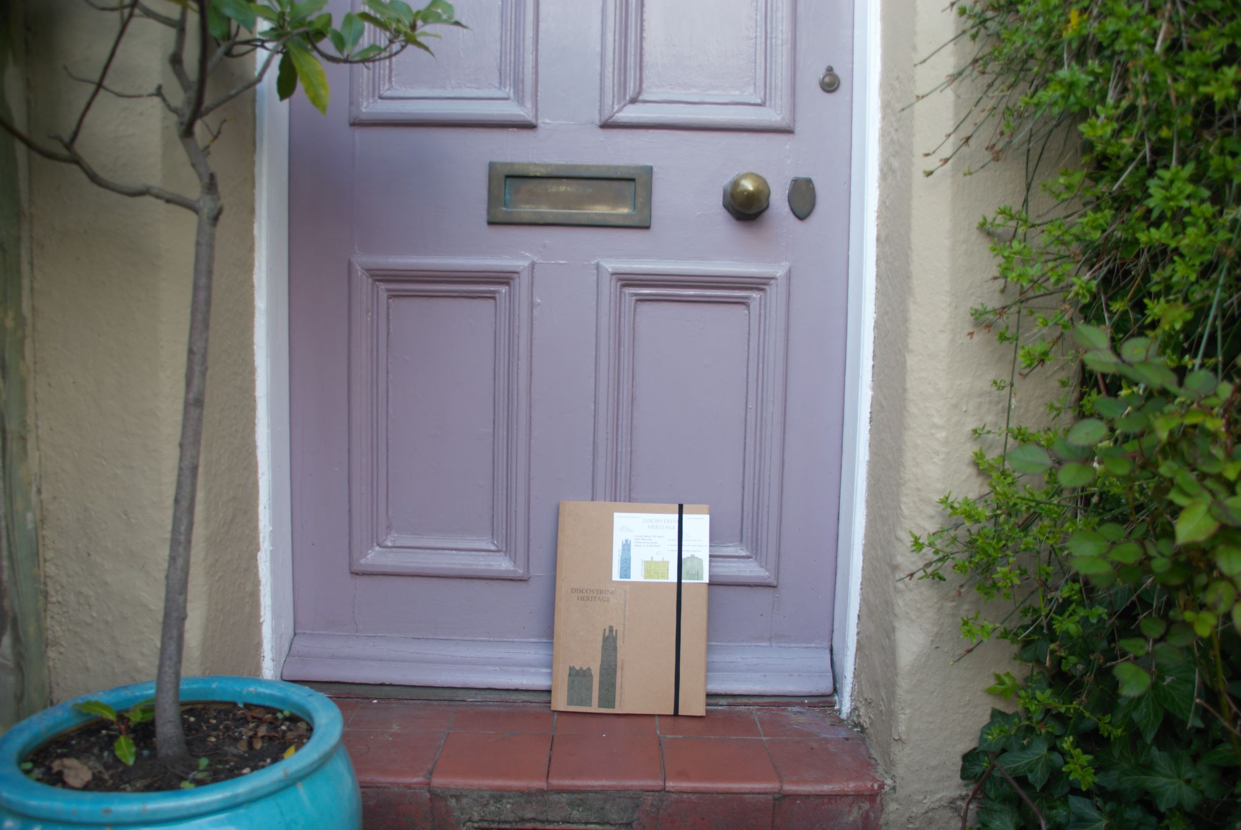 Front doorstep with Discovering Heritage House History pack by the door.