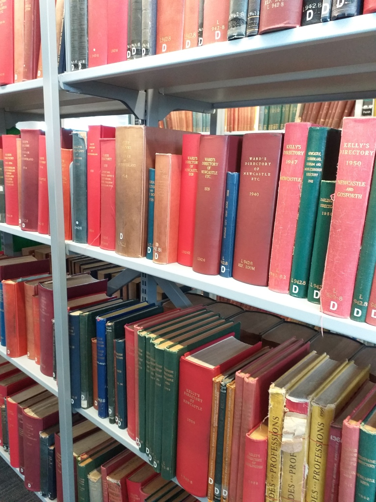 Row of directories used in house history research