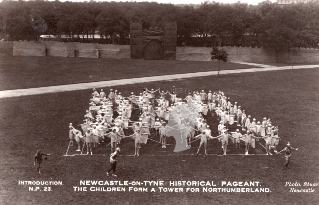 copy postcard of Newcastle Historical Pageant of the North. The children form a tower for Northumberland.
